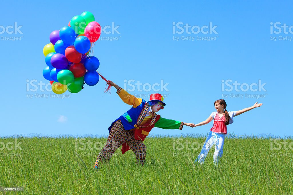 Clown and Girl stock photo
