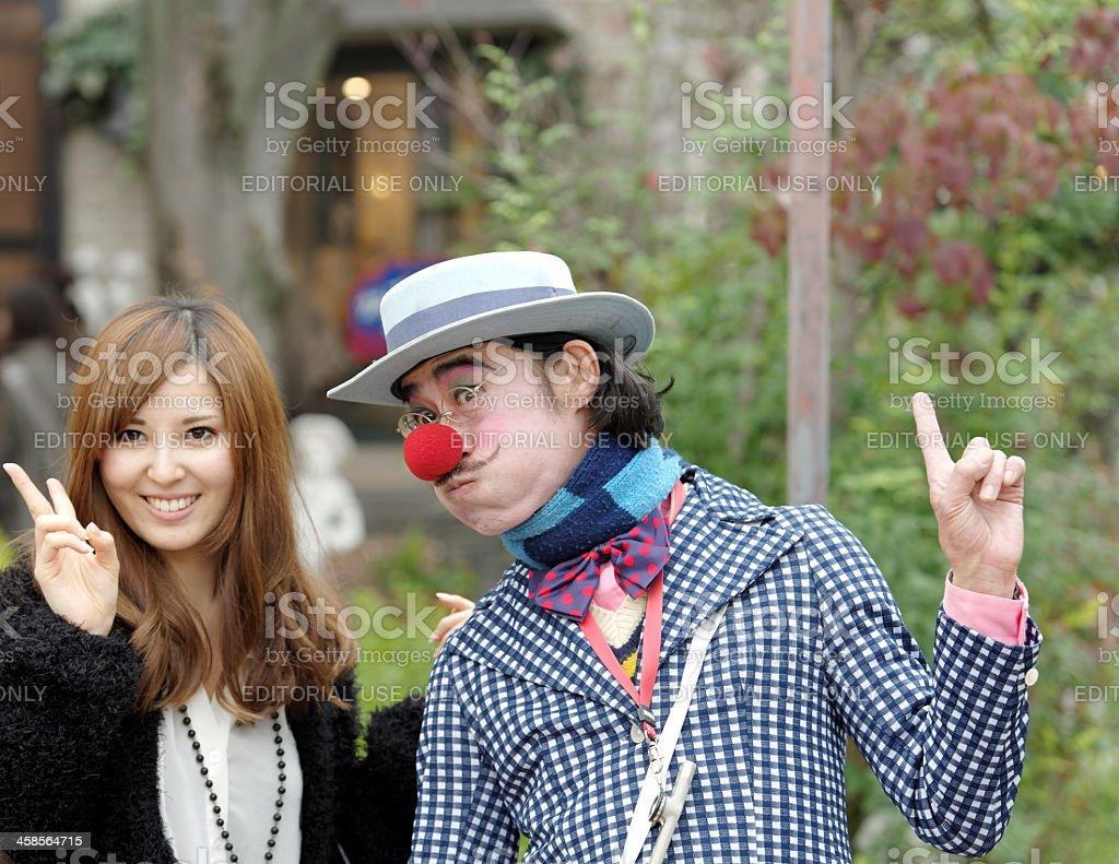 Clown and Japanese woman in streets of Arashiyama,Japan stock photo
