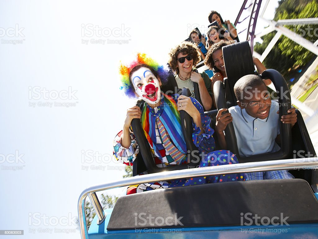 clown and people on a roller coaster stock photo