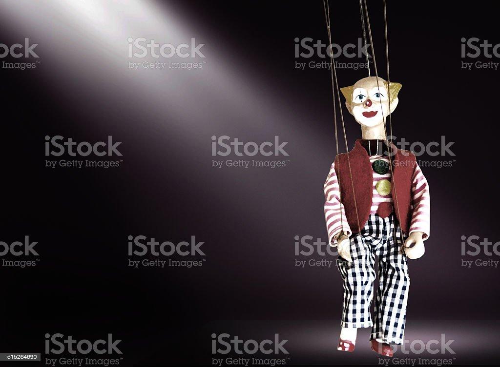 Clown doll in a spotlight stock photo