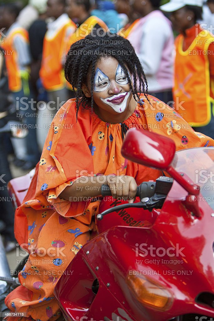 Clown girl on motorbike royalty-free stock photo