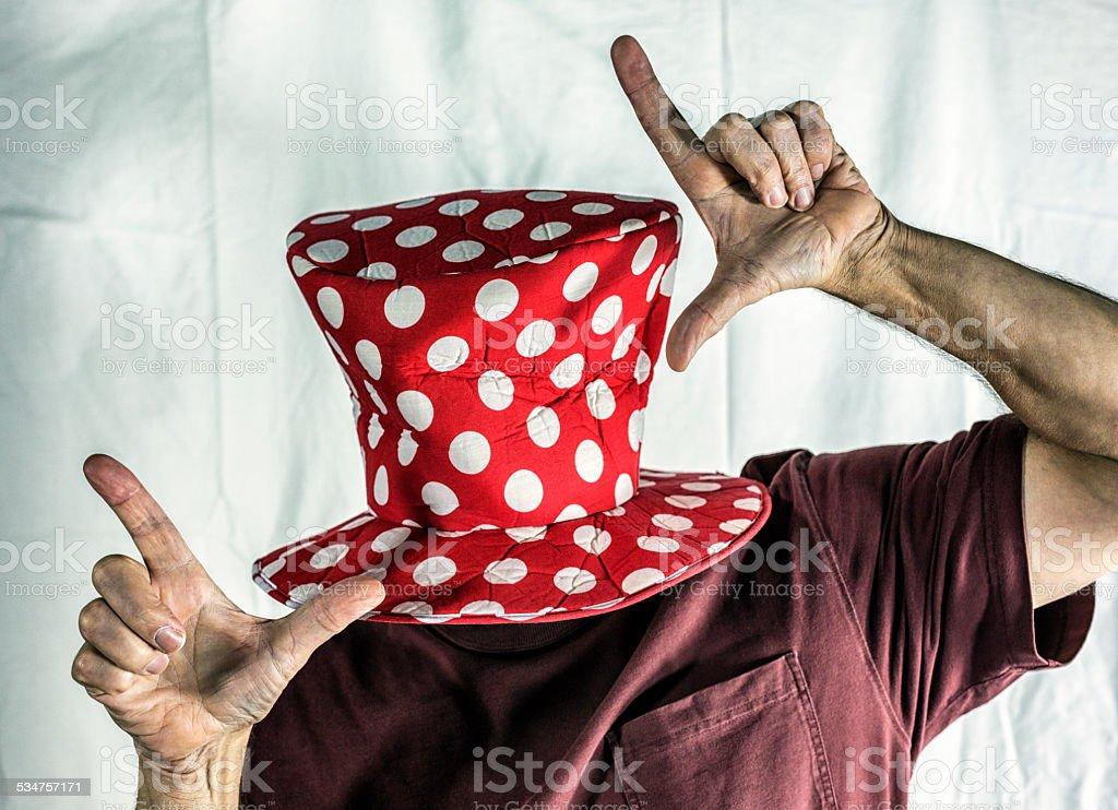 Clown Hat Finger Framing Anonymous Man stock photo