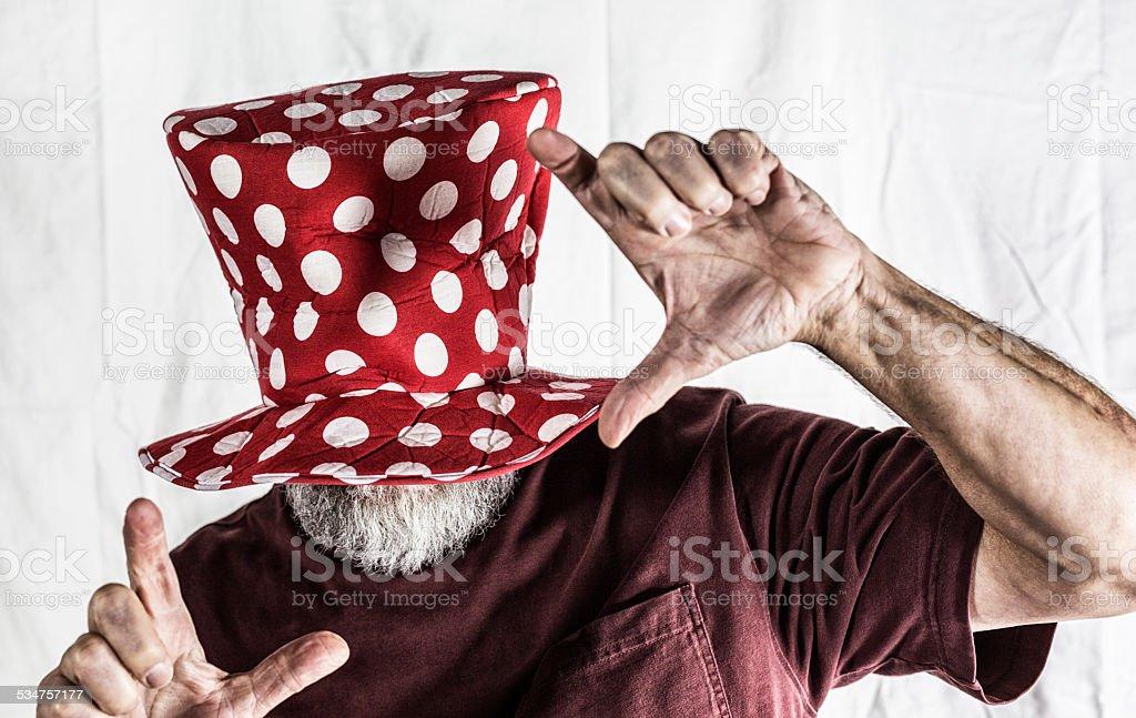 Clown Hat Senior Man Finger Framing stock photo