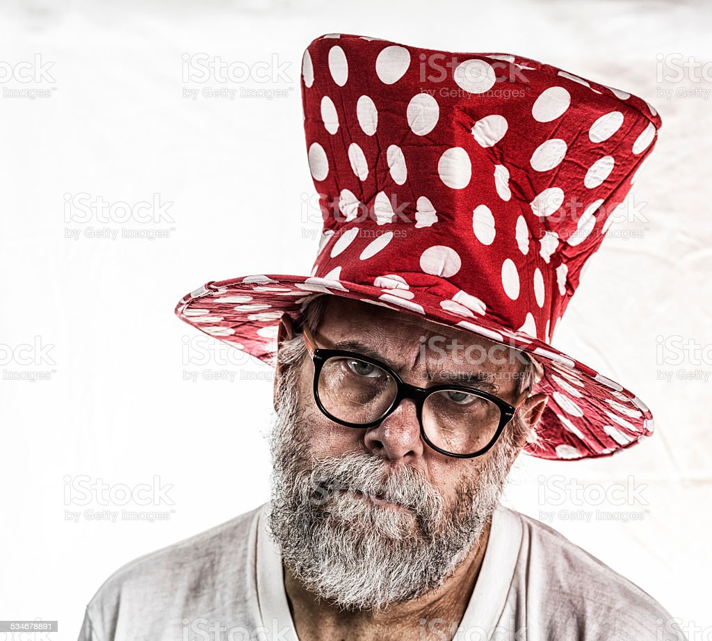 Clown Hat Senior Man With Angry Frown stock photo
