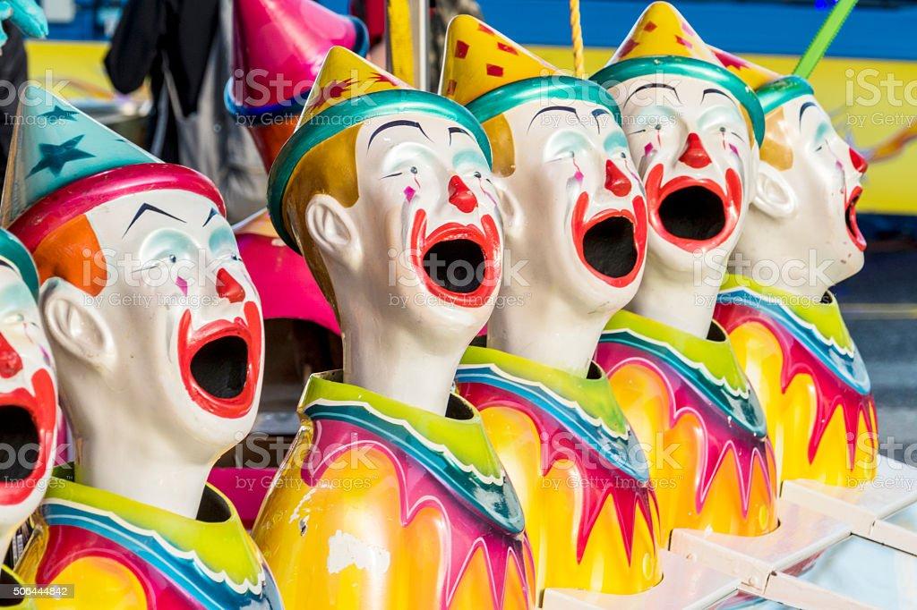 Clown Heads in a Row at Fun Fair stock photo