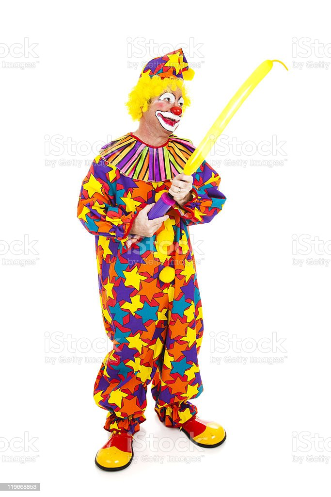 Clown Inflates Balloon Animal royalty-free stock photo