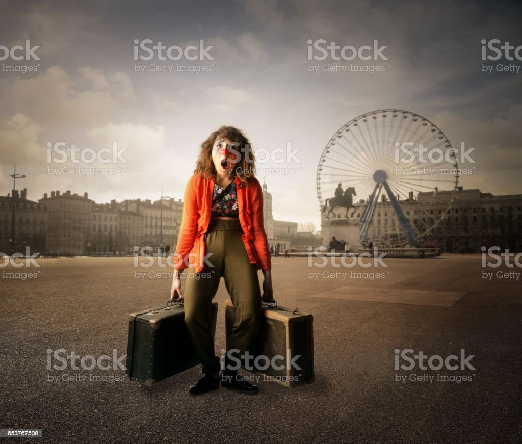 Clown is tired of travelling stock photo