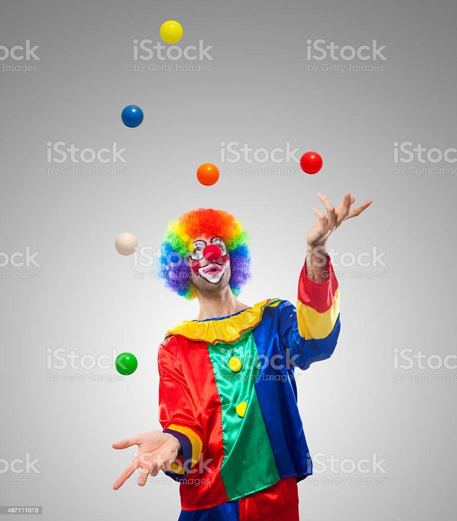 Clown juggling balls stock photo