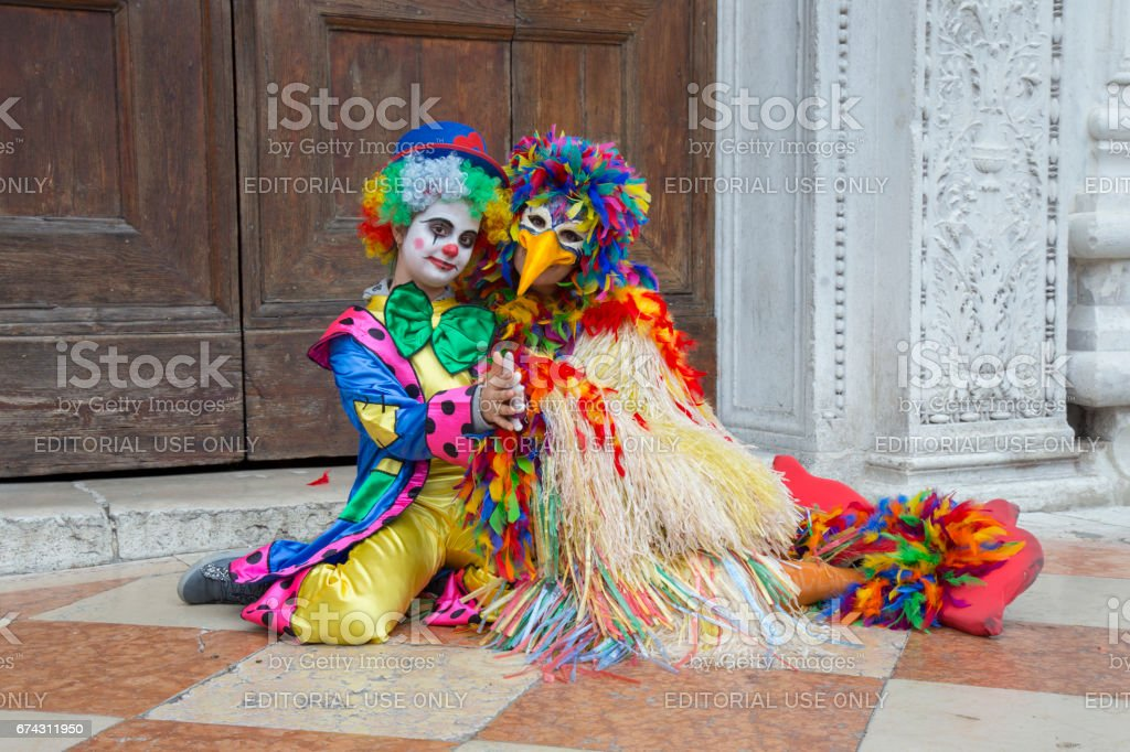 Clown mask on Venice Carnival - Jester Mask in colorful costume on St. Mark's Square in Venice stock photo