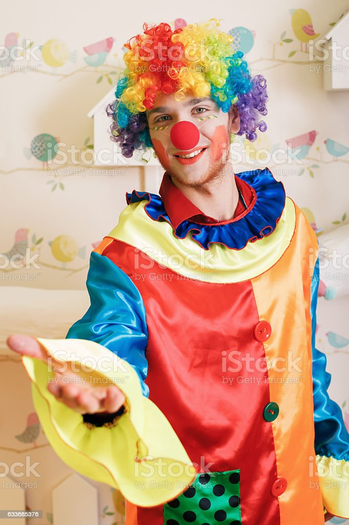 Clown offers friendship. stock photo