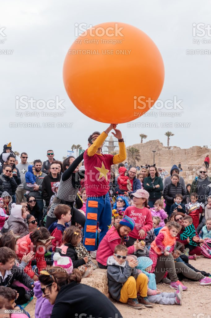 Clown on festival shows his art for children stock photo