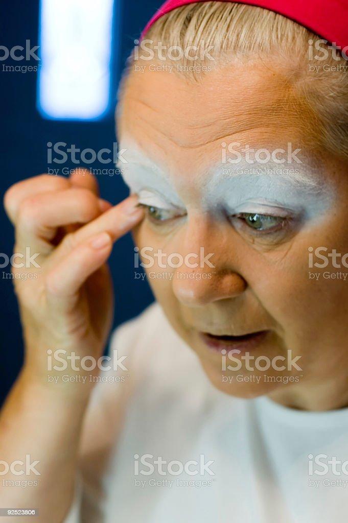 Clown Putting on Makeup 3 stock photo