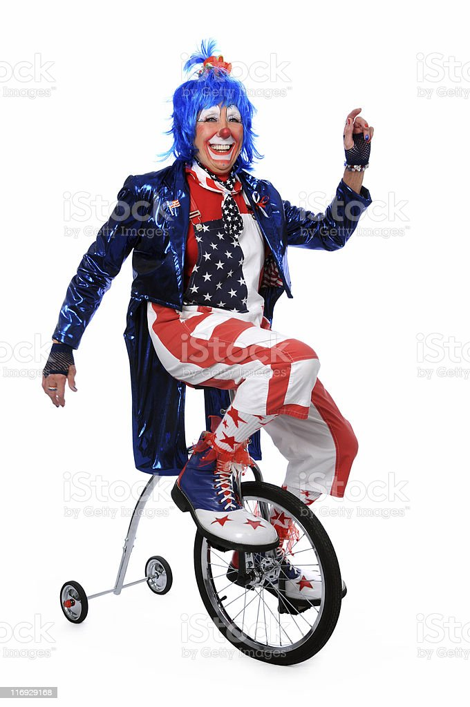 Clown Riding Unicycle with Training Wheels stock photo