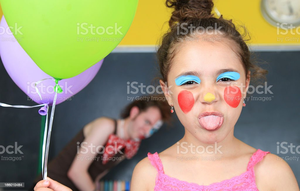 Clown School: Child making faces stock photo