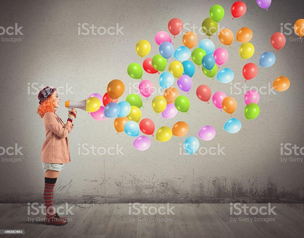 Clown screams balloons stock photo