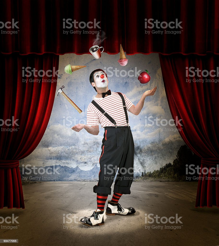 A clown that's juggling ice cream, coffee, Apple, and hammer stock photo