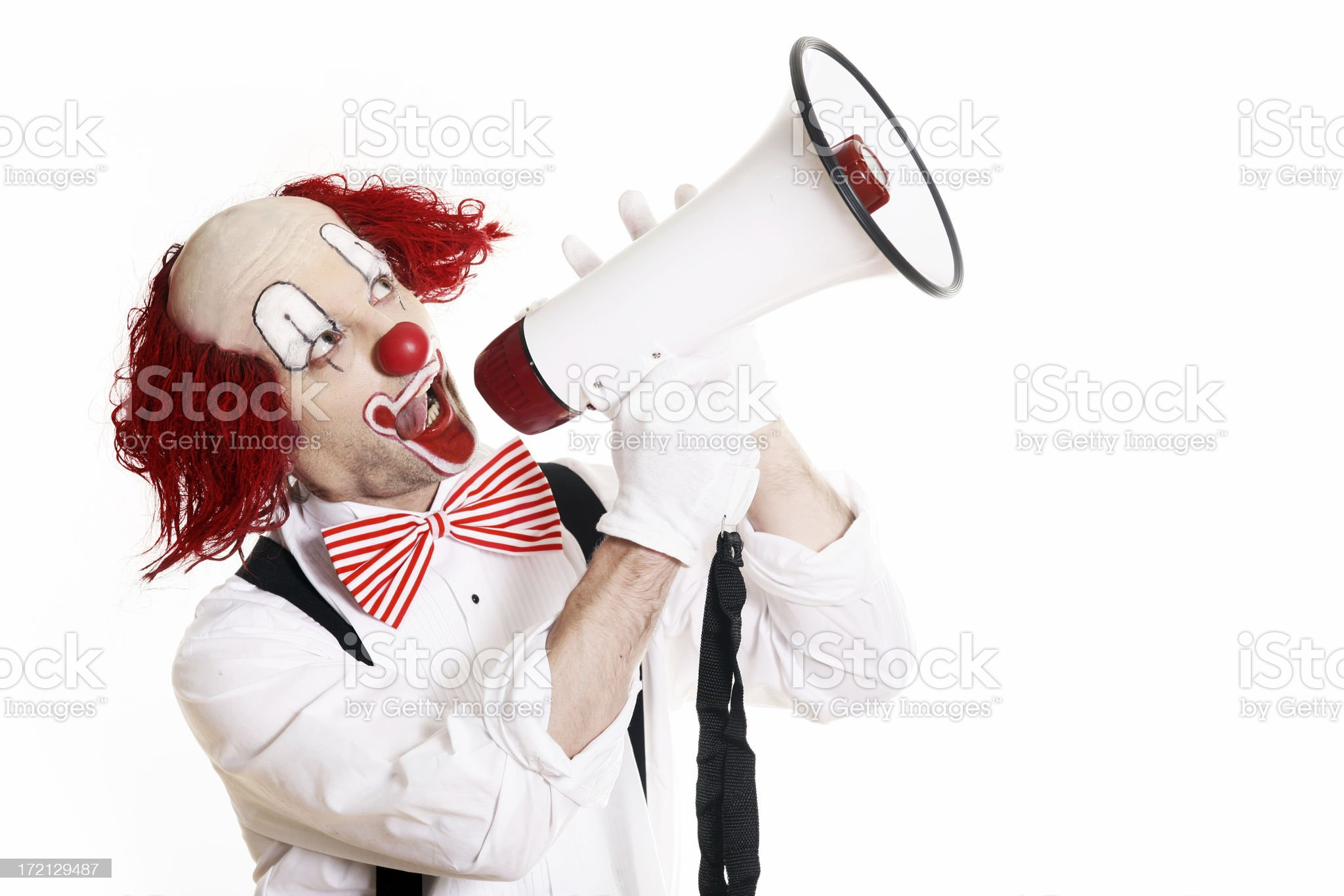 Clown yelling through a megaphone royalty-free stock photo