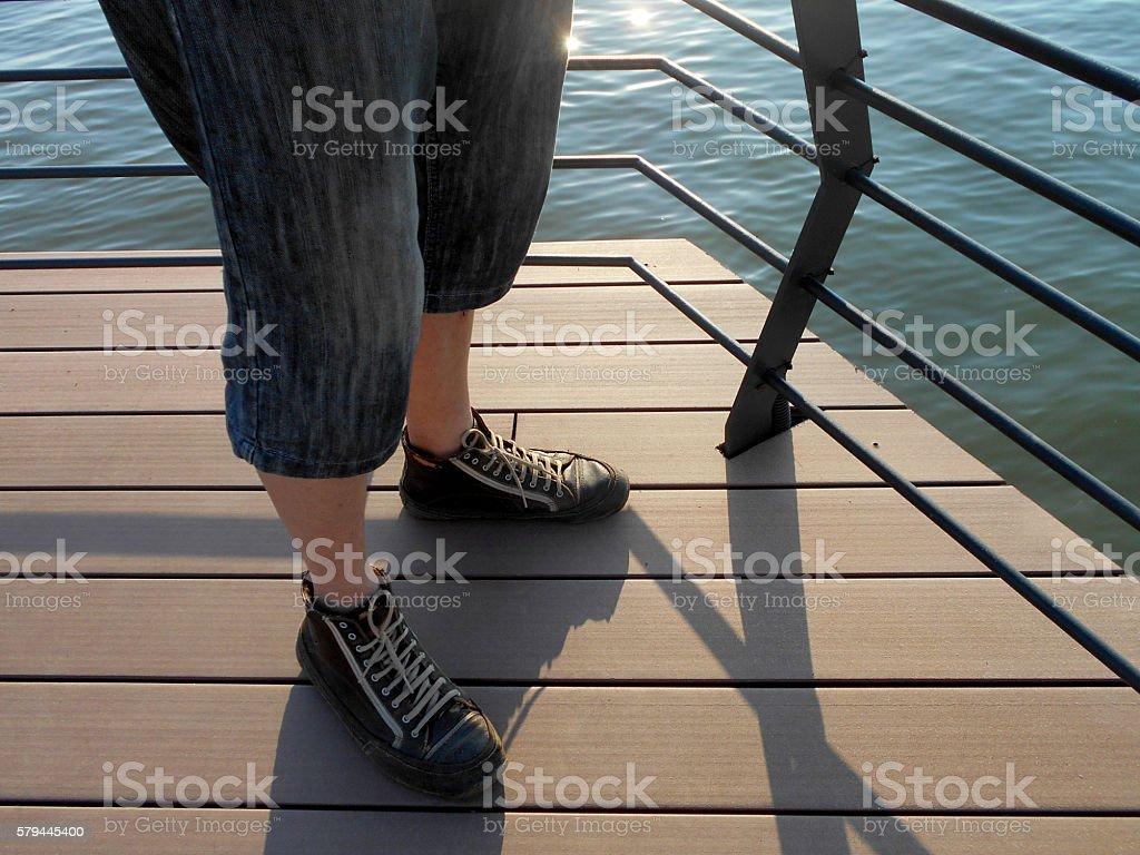 clownish feet on the waterfront stock photo