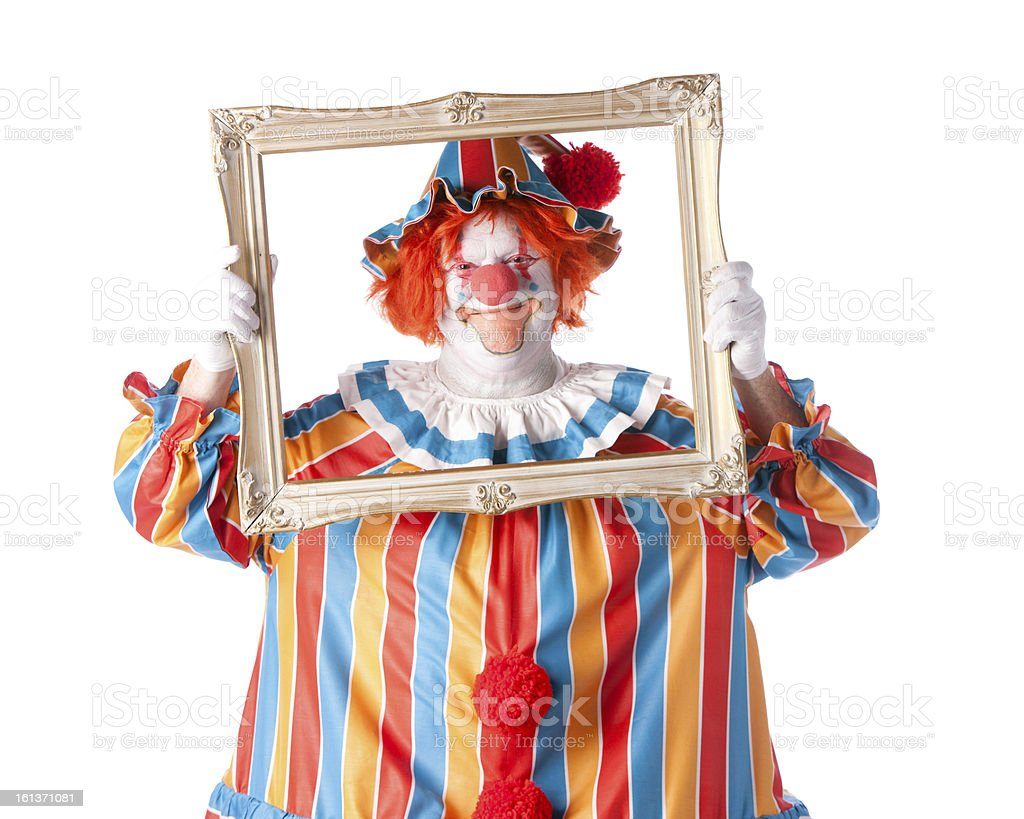 Clowns: Adult Male Smiling Holding Picture Frame Around Face royalty-free stock photo