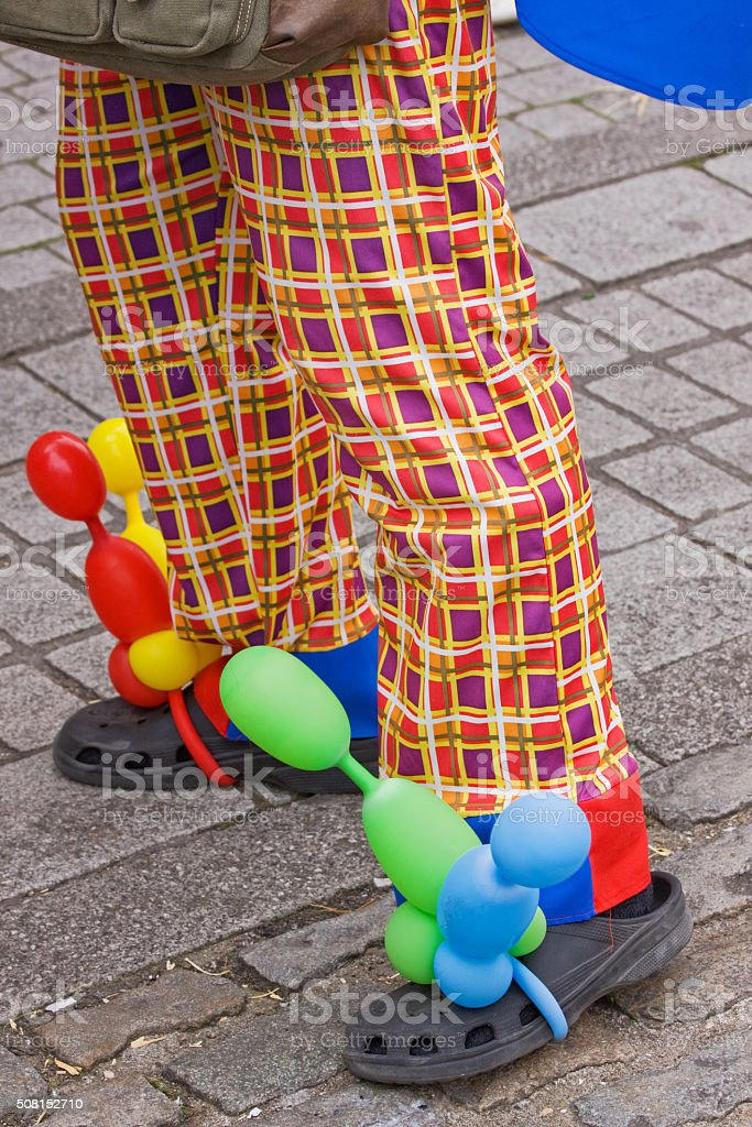 Clown's colourful trousers and footwear at a UK carnival stock photo