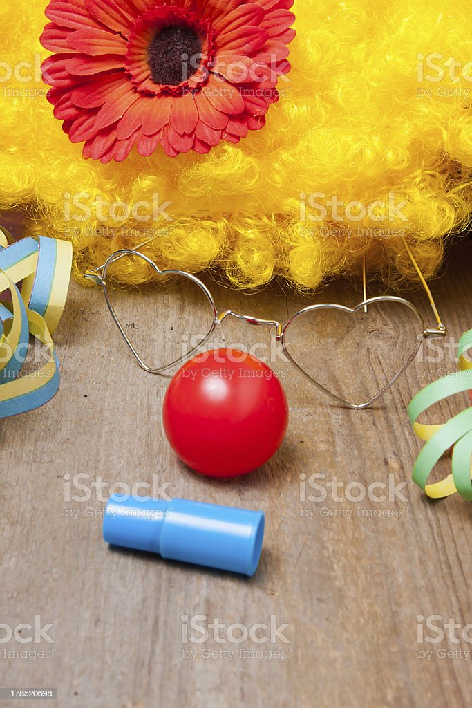 Clowns costume on a wooden board royalty-free stock photo