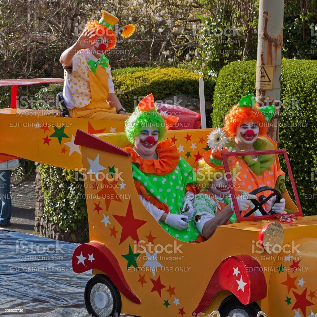 Clowns riding in their car in the Grand Carnival, Torrington stock photo