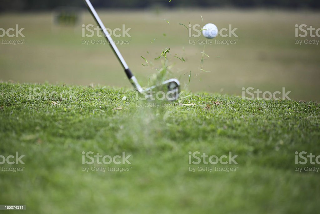 Club Hitting Golf Ball in the Air royalty-free stock photo