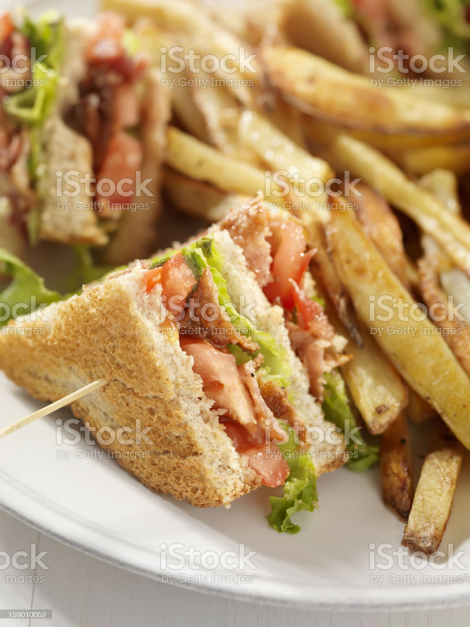 BLT Club House Sandwich with French Fries royalty-free stock photo