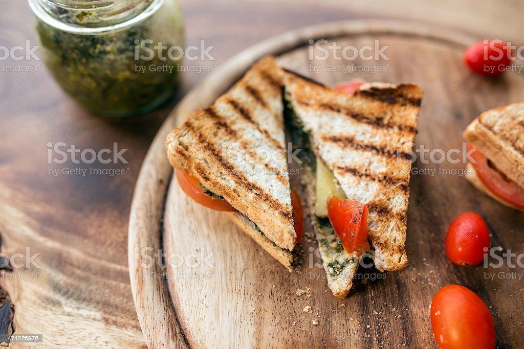 Club sandwich with pesto,tomota and mozzarella stock photo