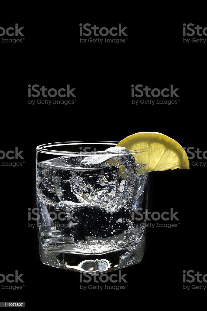Club Soda or Vodka Tonic Cocktail on black background royalty-free stock photo