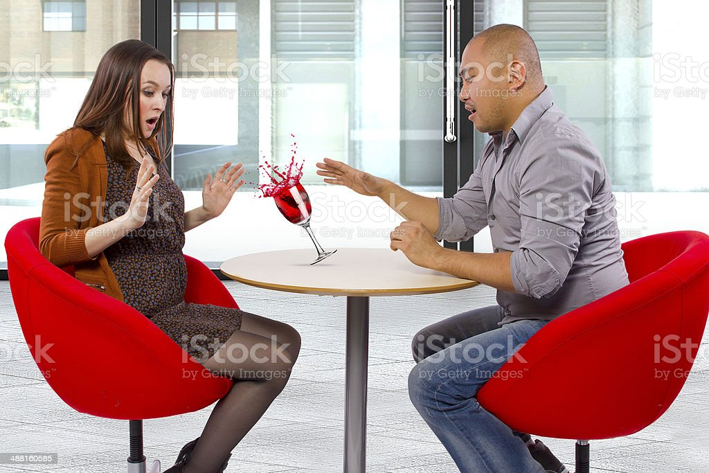 Clumsy Male Spilling a Drink on Female Date stock photo