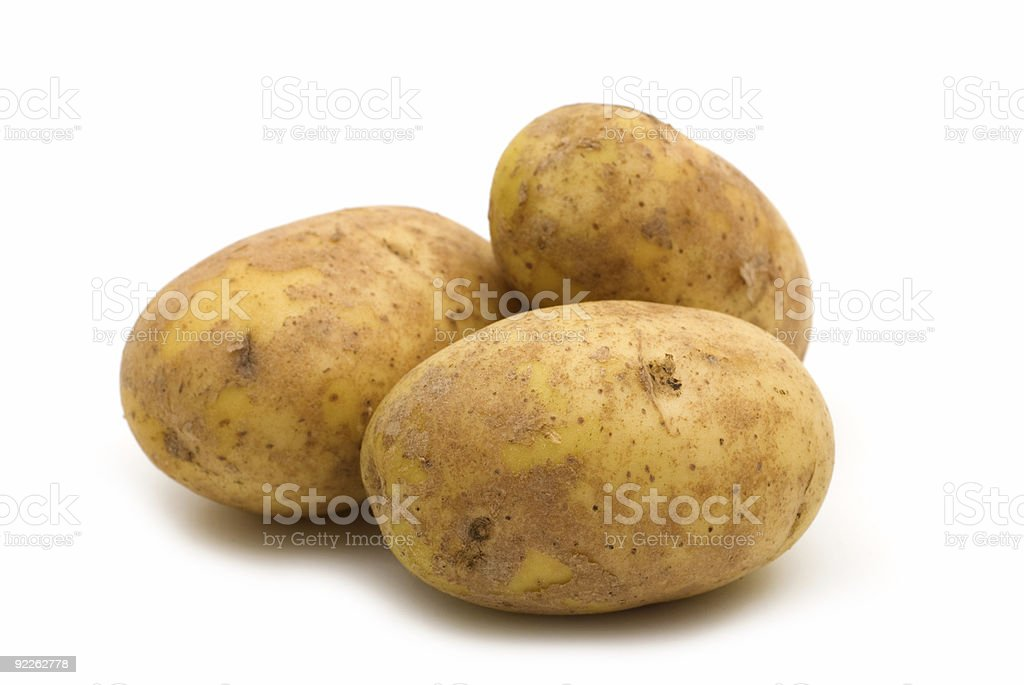 Cluster of brown potatoes on white background stock photo