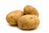 Cluster of brown potatoes on white background