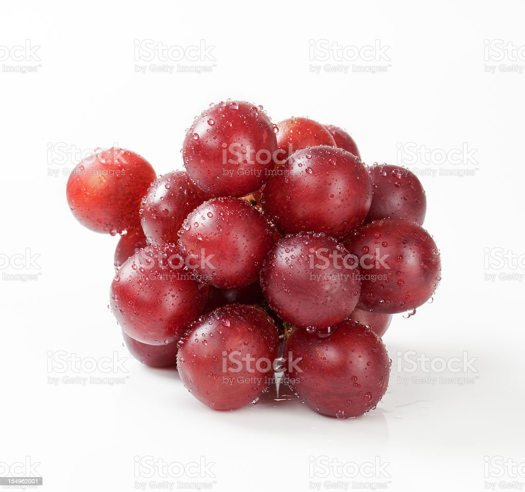 Cluster of red grapes on a white background stock photo