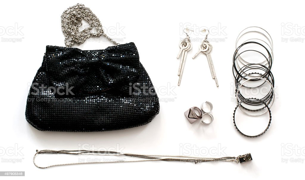 Clutch bag with accessories stock photo