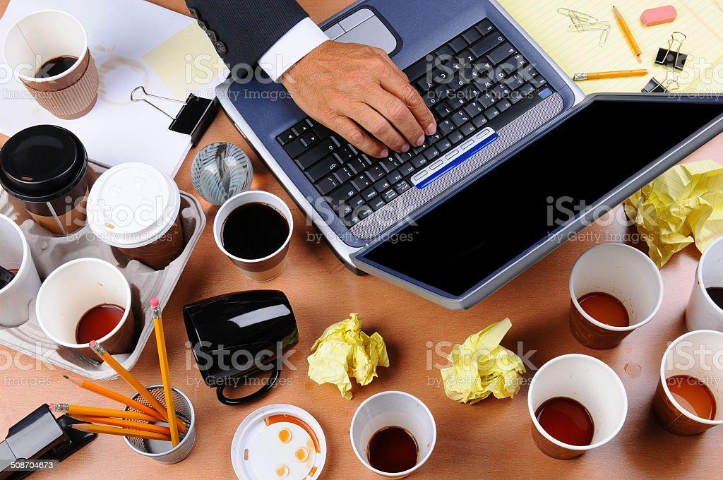 Cluttered Businessman's Desk stock photo
