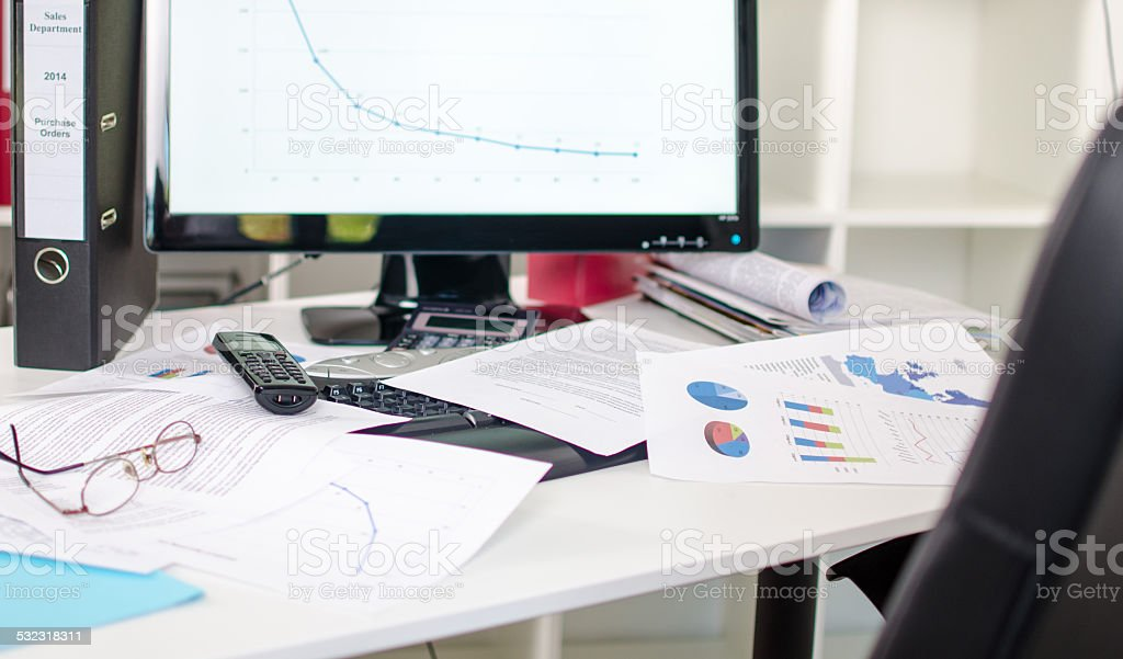 Cluttered desk stock photo