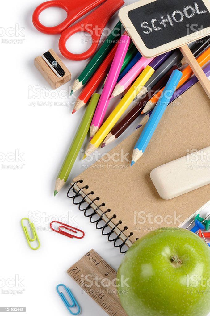 A cluttered pile of a child's school stationery stock photo