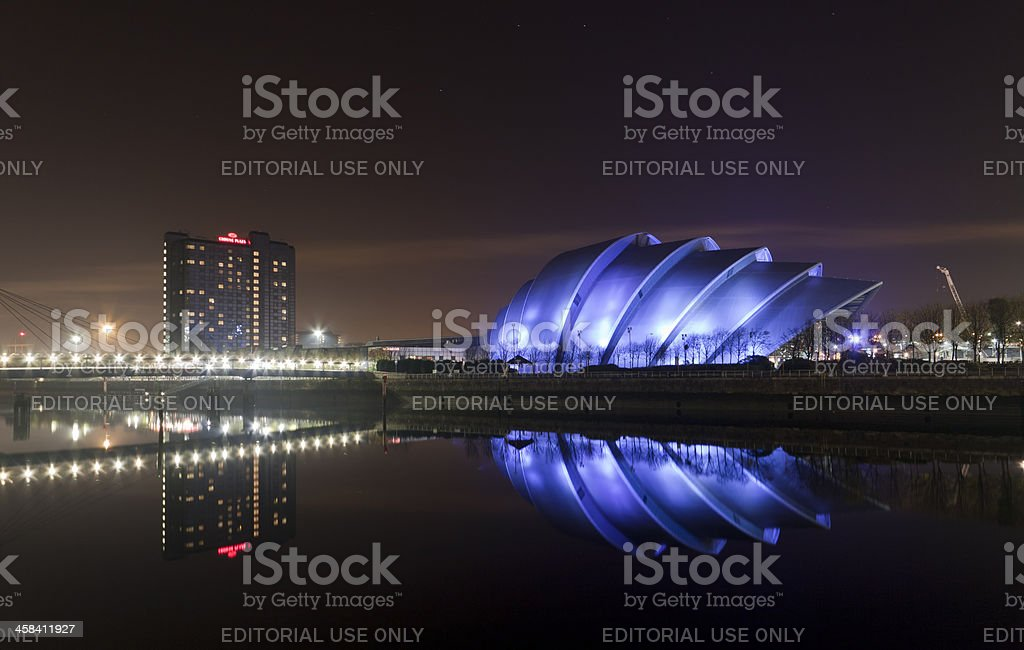 Clyde Auditorium reflected in the River at night. stock photo