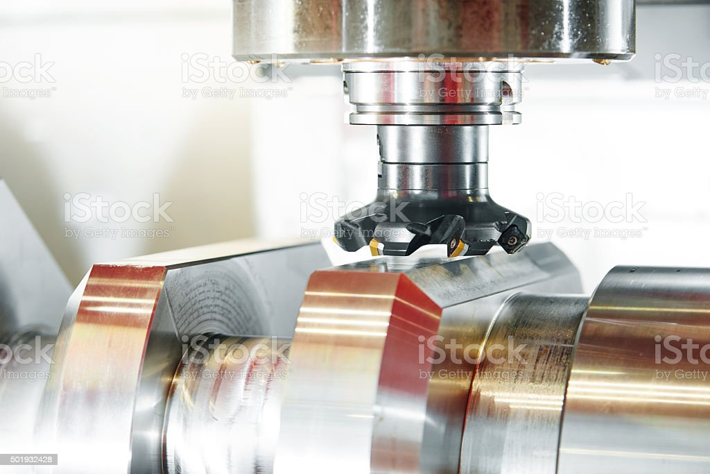 cnc metal working machining center with cutter tool stock photo