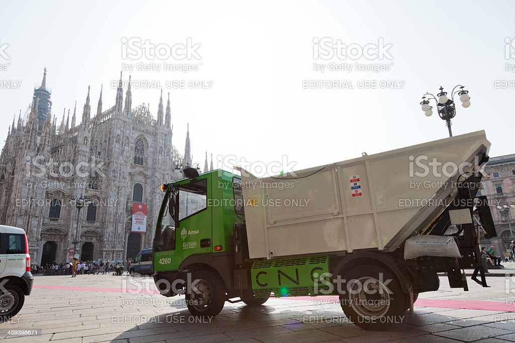 cng-powered garbage truck in the piazza duomo, milan stock photo