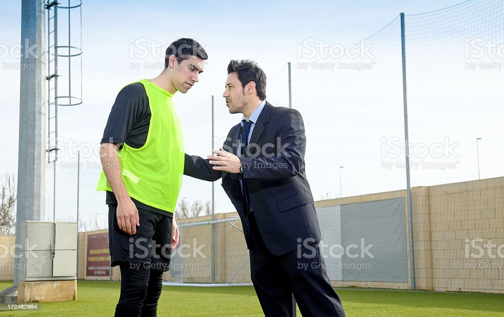 Coach a soccer plaer royalty-free stock photo