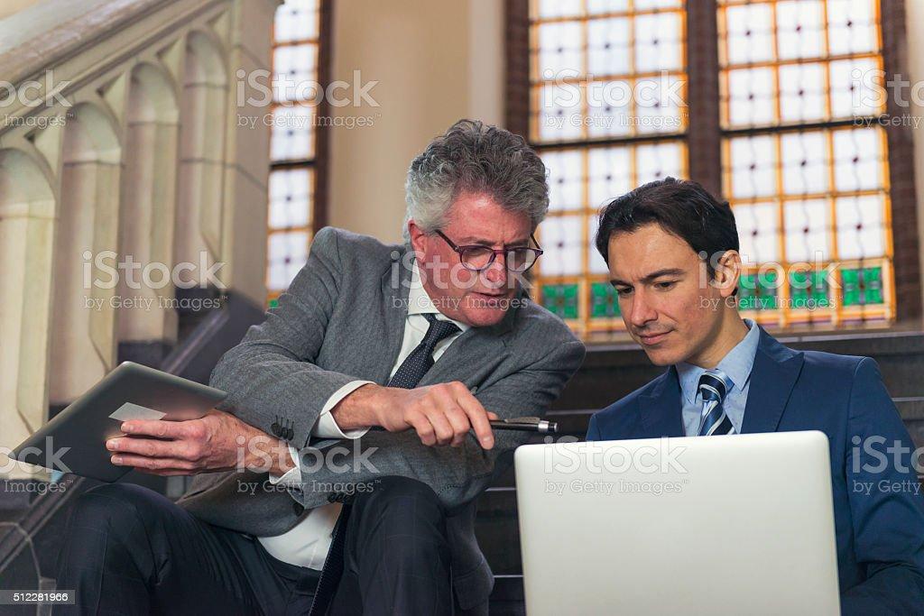 Coach and apprentice stock photo