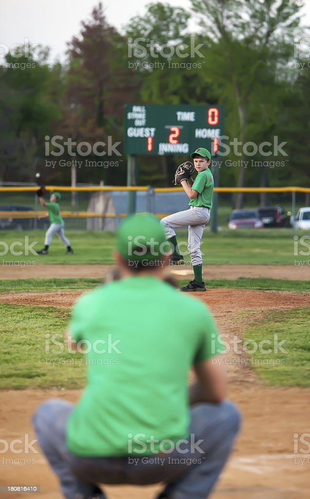coach dad catches for pitcher son royalty-free stock photo
