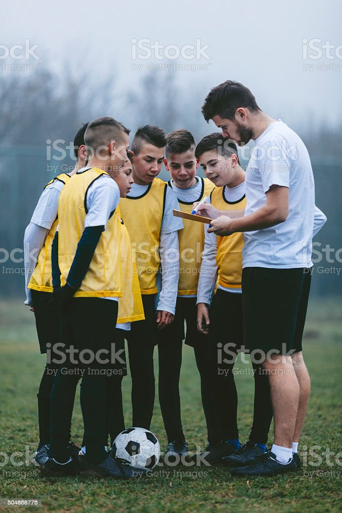 Coach Giving Instruction To His Kids Soccer Team stock photo
