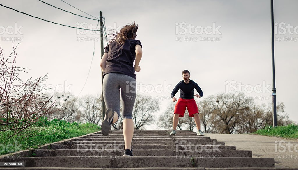 coach is encouraging athlete for her workout stock photo