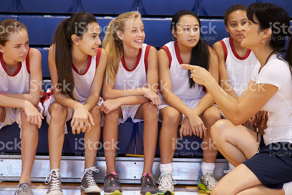 Coach Of Female High School Basketball Team Gives Team Talk stock photo