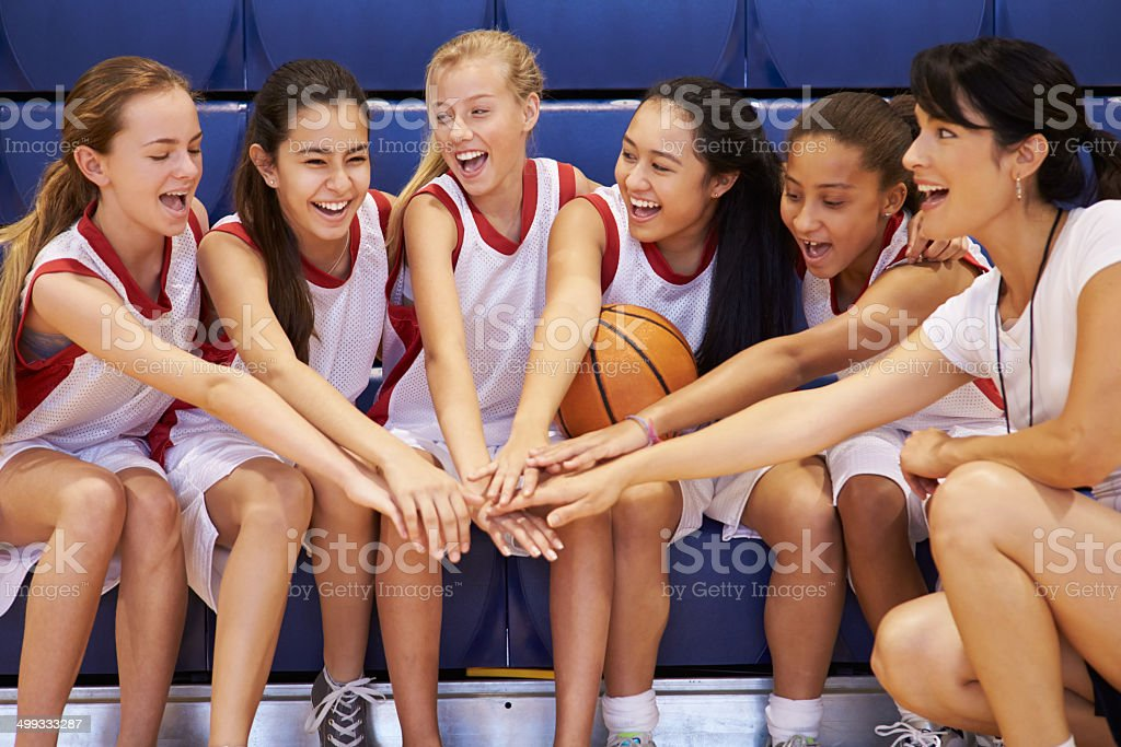 Coach Of Female High School Basketball Team Gives Team Talk stock photo