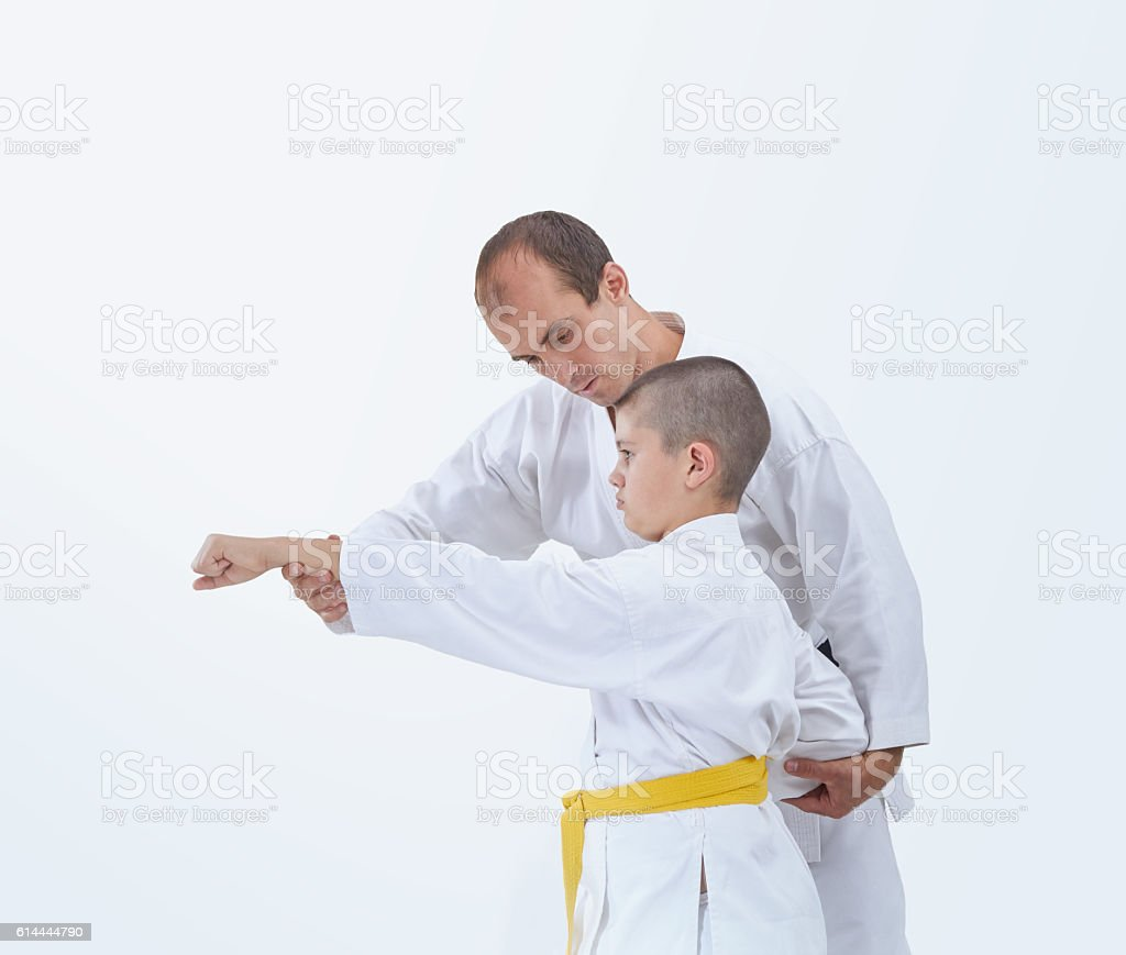 Coach teaches the athlete to beat a punch arm stock photo