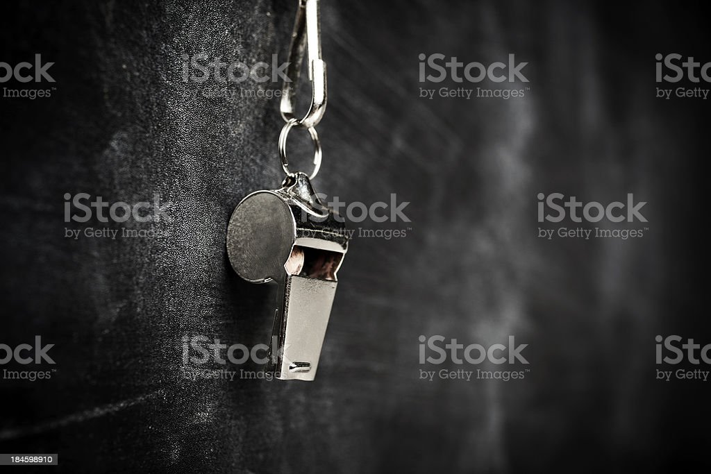 coach whistle hanging from board stock photo